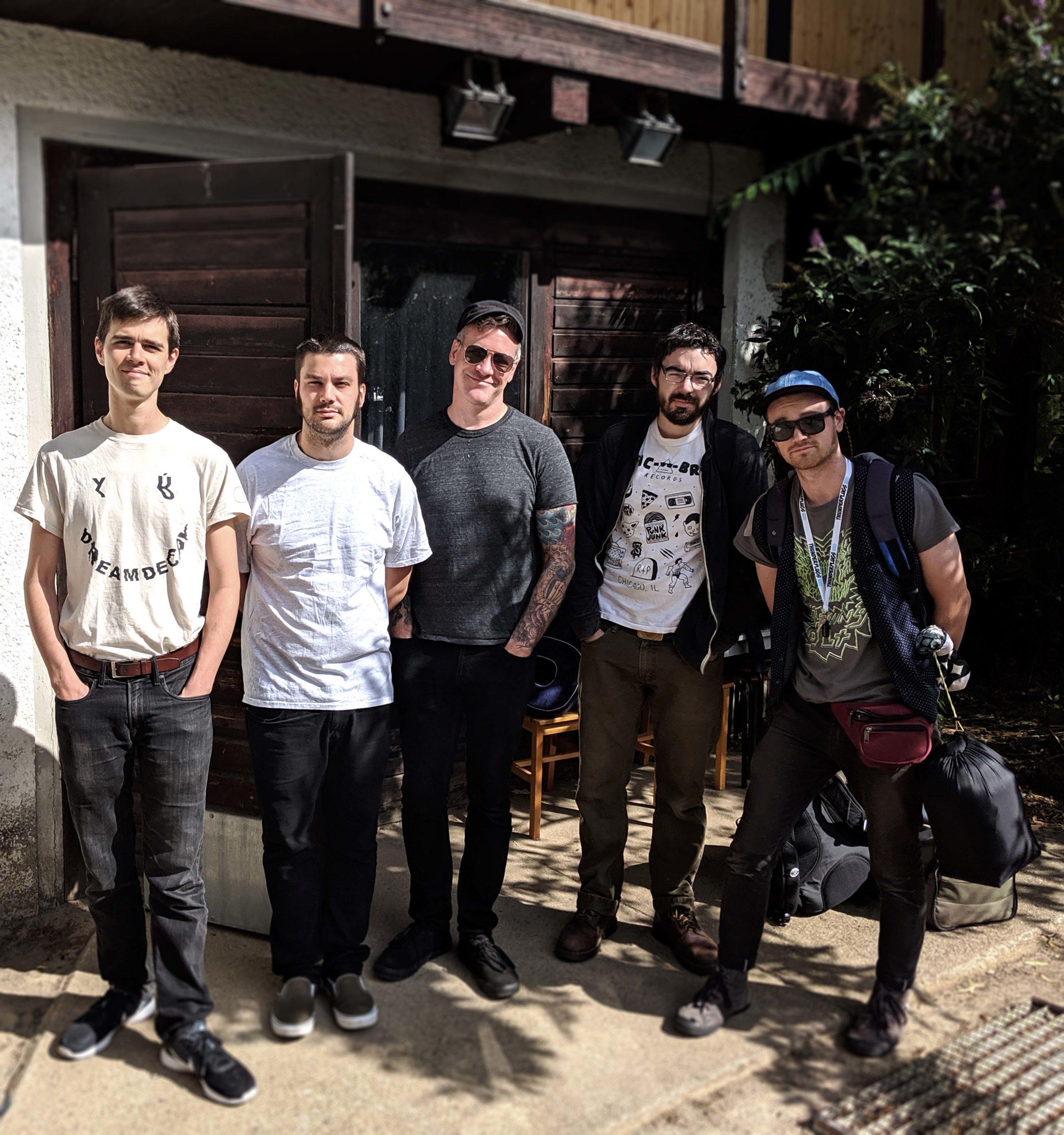 members of the band Landowner standing on a sidewalk in Leipzig
